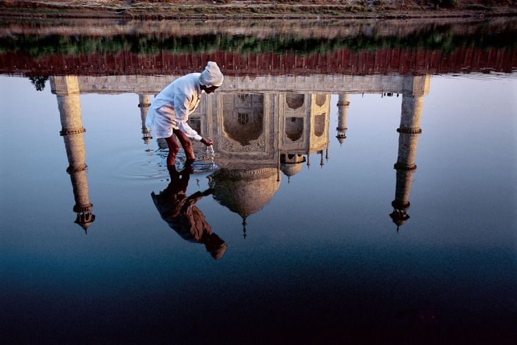 "Reflection in the Yamuna River of the Taj Mahal, completed in 1638 by the Mughal emperor Shah Jahan after the 1629 death of his favorite wife, Mumtaz Mahal.Steve McCurry: Photographs of Asia. Boca Raton Museum. 2004, 58.  ""When you do a story in India, y"